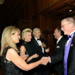 PEN/Faulkner board members Frazier O'Leary, George Pelecanos, and Mary Haft greet Gala attendees.