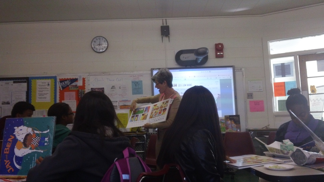 Author Lulu Delacre reads her illustrated book Jay and Ben to participants in the Teen Parent Book Club.