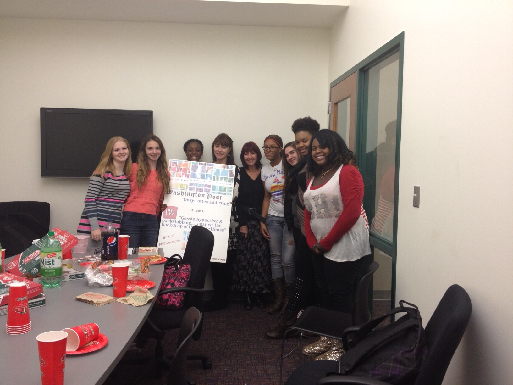 The authors pose with students following a book club meeting.