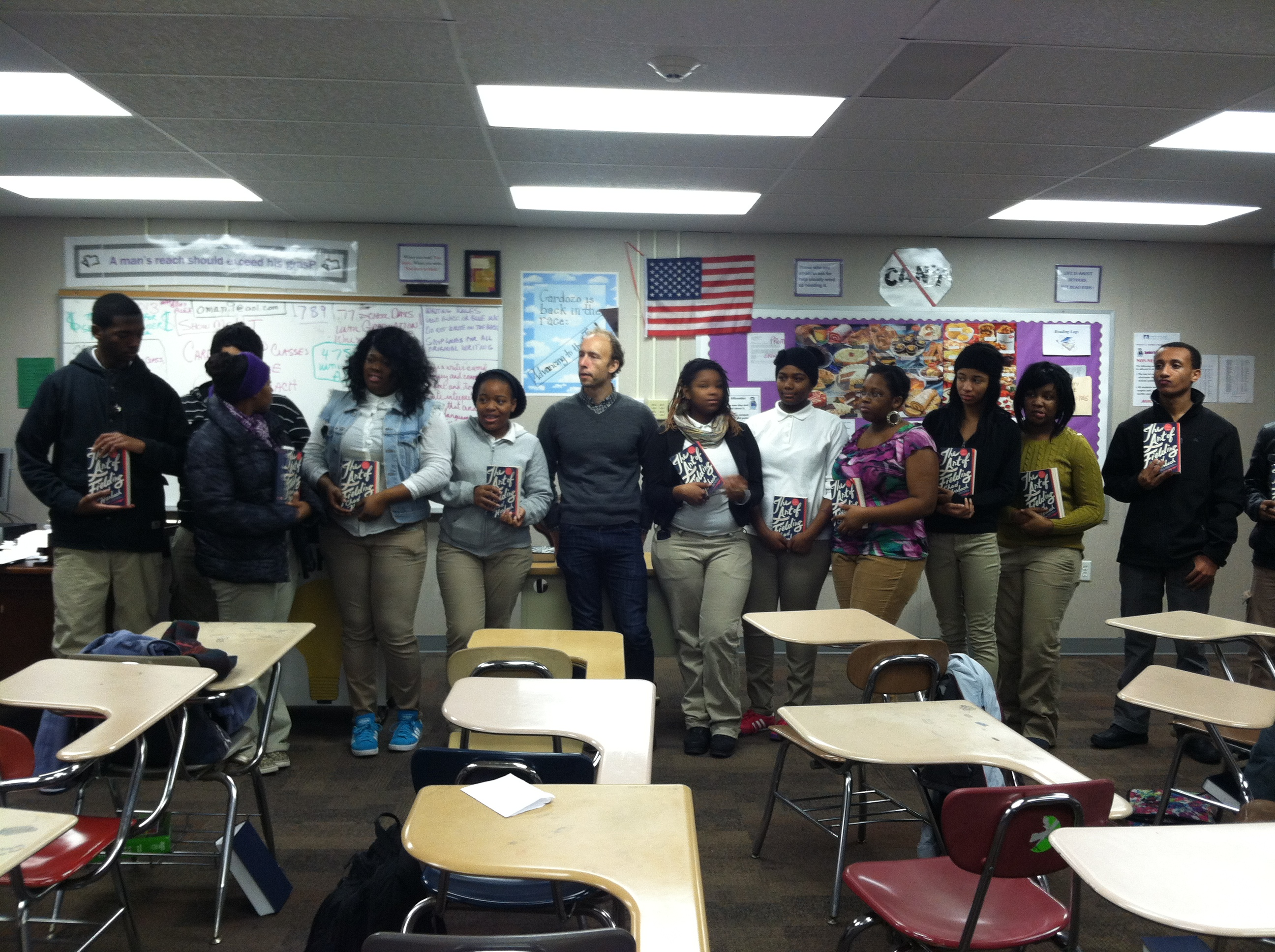 Author Chad Harbach poses with students from Cardozo High School.