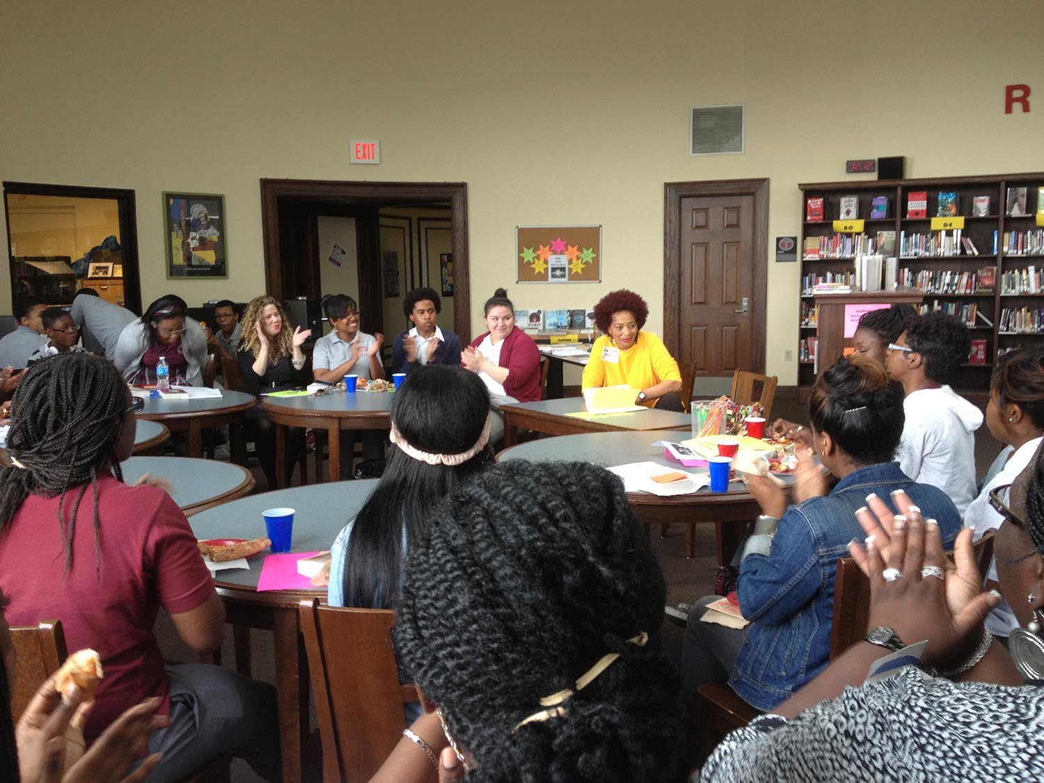 Terry McMillan visits with students at McKinley Technical High School