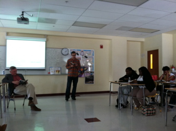 Author Rob Roensch reads a story to a class at Paul Laurence Dunbar High School during a late-April Writers in Schools Visit