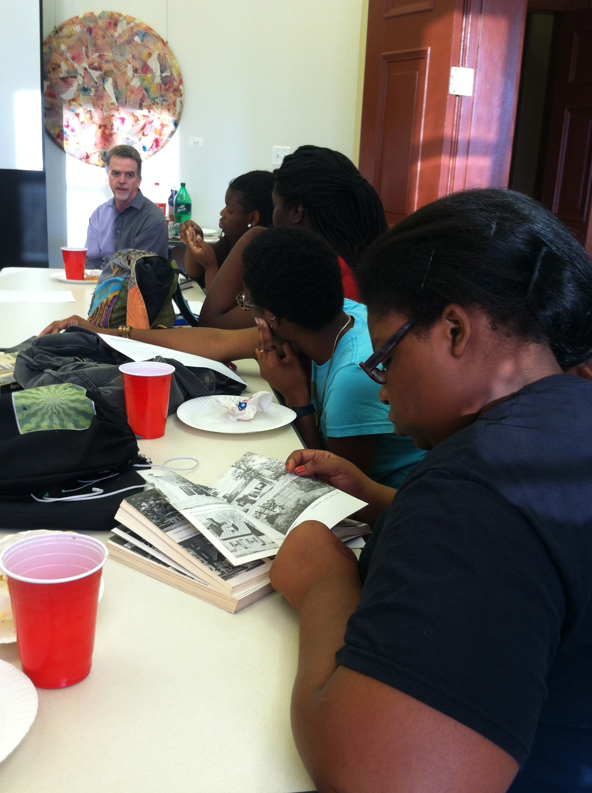 Students examine the WPA Guide to Washington, DC as David A. Taylor talks about the Federal Writers' Project.