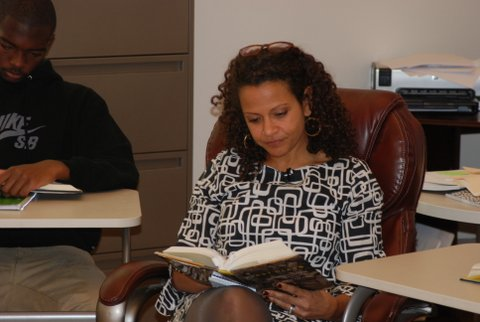 Alison Stewart reads along with students at Cardozo