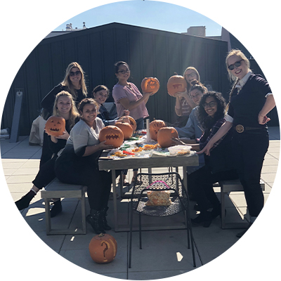 InternsCarvingPumpkins