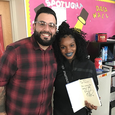 Author and Student hugging and smiling