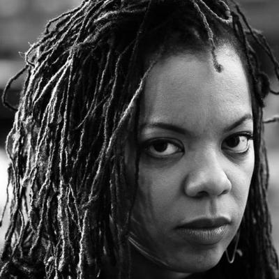 Black and white headshot of writer Airea D. Matthews, a Black woman