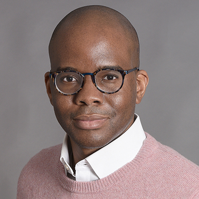 Headshot of Tope Folarin, a Black man wearing glasses and a light pink sweater