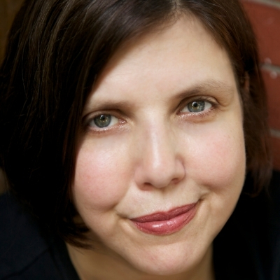 Headshot of author Jenny Offill, a White woman with short brown hair