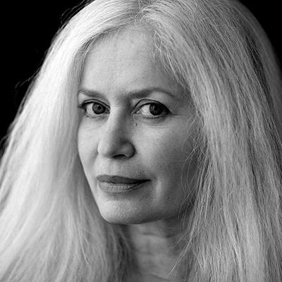 Black and white headshot of author Amy Hempel, a White woman