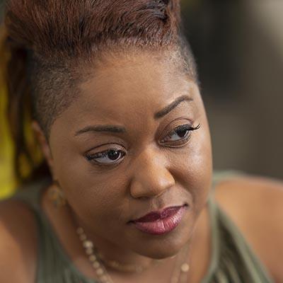 Headshot of author DaMaris B. Hill, a Black woman wearing a green top