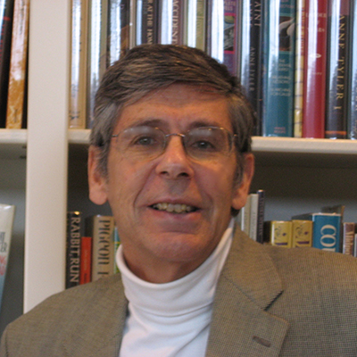 Headshot of Jackson R. Bryer, a White man wearing glasses and a gray blazer